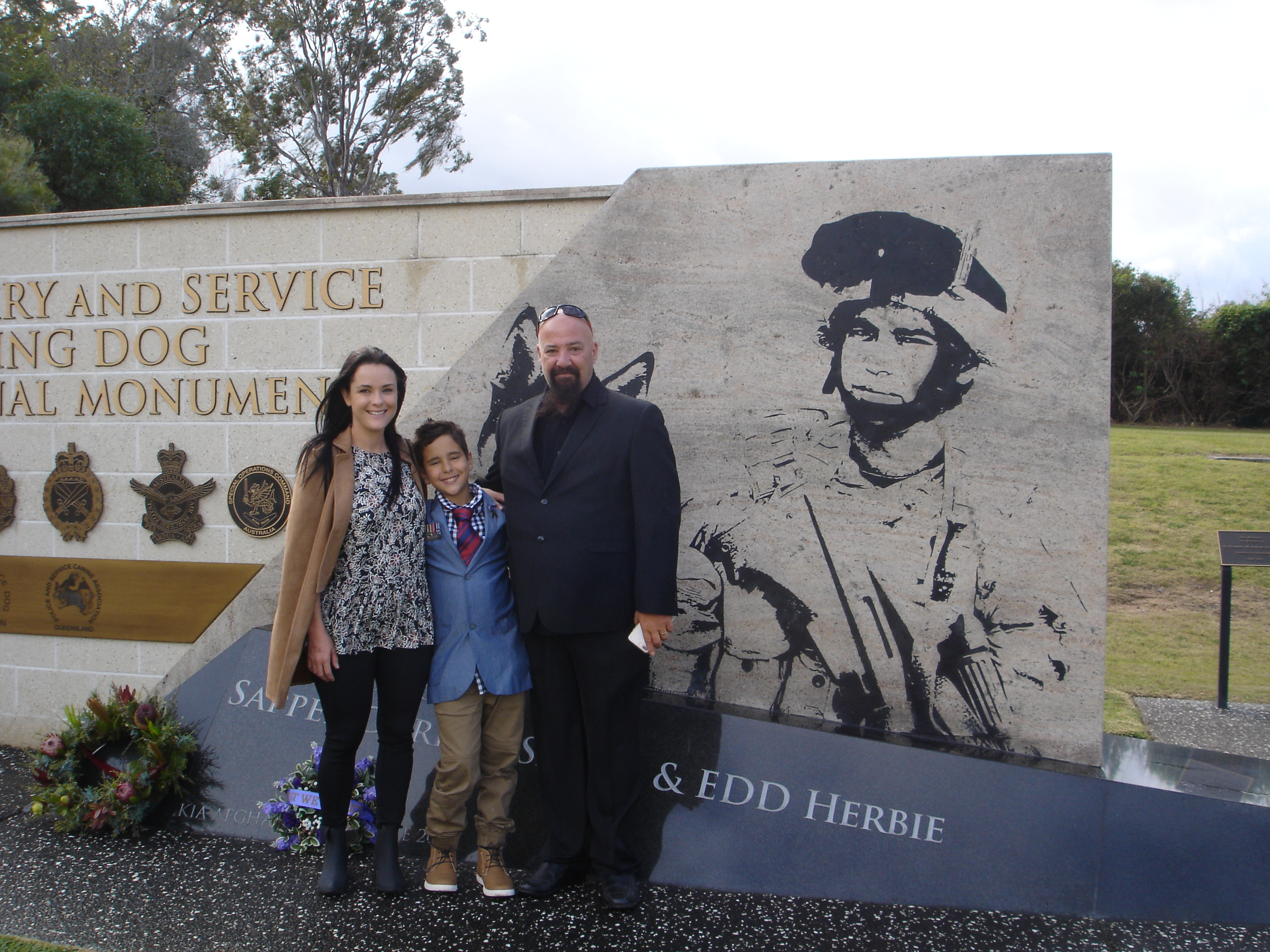 Angela, Mason and Graeme Smith at the monument 7 June 2018.
